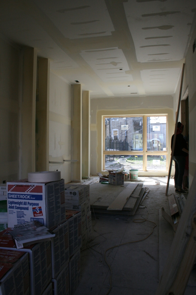 First floor, looking toward the back. The wall to the left will be all bookshelves.